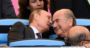 Russian president Vladimir Putin  and then to Fifa president Sepp Blatter during the 2014 World Cup final between Germany and Argentina at the Maracana stadium in Rio. Photograph: Reuters/Dylan Martinez