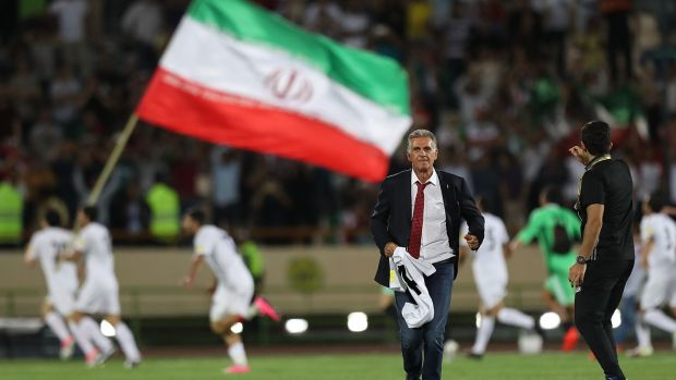 Head coach Carlos Quieroz and players celebrate after Iran's win over Uzbekistan in Tehran. Photograph: Amin M Jamali/Getty Images