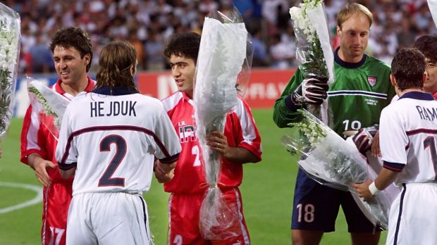 Iranian players offer flowers to US players before the 1998 World Cup Group F first-round match in Lyon. Iran won 2-1. Photograph: Patrick Kovarik/AFP/Getty Images