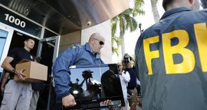 "An FBI raid on offices in the US. In April Leo Varadkar promised  that the Government would ""beef up the role of the Office of the Director of Corporate Enforcement"" to make it a ""a sort of Irish FBI, if one likes, when it comes to white-collar crime"". Photograph: Getty Images"