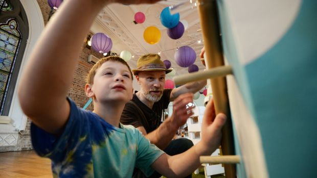 Barra and Cristoir O'Duill constructing a marble run at The Curiosity Carnival in Smock Alley, Dublin. Photograph: Alan Betson / The Irish Times