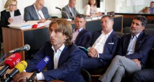 Luka Modric appears in a court in Osijek to testify in the corruption trial against former Dinamo Zagreb executive Zdravko Mamic. Photograph: STR/AFP/Getty Images