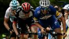 France's Julian Alaphilippe (right) sprints ahead of Ireland's Daniel Martin (centre) and Britain's Geraint Thomas  to win the fourth stage of the  Criterium du Dauphine in France. Photograph: Getty Images
