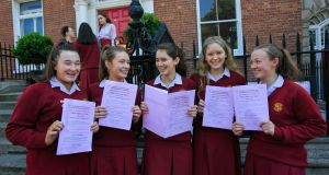 Loreto On The Green, Dublin,  students Ruth Redmond, Ashbourne; Amber McCann, Rush; Jane Loughrey, Ranelagh; Eavan O'Toole, Rathgar and  Sophie Dolan, Rathgar, following their Leaving Cert English exam. Photograph: Gareth Chaney/Collins