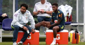 Brazil's Fred watches from the sidelines after suffering an injury during the training session at Enfield Training Ground, London. Fred is on the cusp of a move to Manchester United. Photo: John Walton/PA Wire