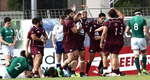 The Georgia team celebrate scoring a try during their win over Ireland at the under-20 World Cup in France. Photo: Inpho