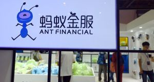 People visit a showroom of Ant Financial in Hangzhou in China's eastern Zhejiang province