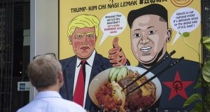 A poster outside a restaurant, Harmony Nasi Lemak, in Singapore, promotes a special Trump Kim-Chi dish on  its menu. Photograph: Ore Huiying/Getty Images