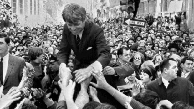 Senator Robert F Kennedy shakes hands with the crowd on a street corner in Philadelphia on April 2nd, 1968, two months before his assassination. Photograph: Warren Winterbottom