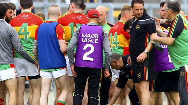 Carlow coach Steven Poacher with the team at half time. Photograph: Ken Sutton/Inpho