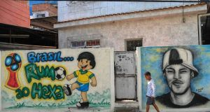 Graffiti related to the Brazilian national football team, striker Neymar and the 2018 World Cup, in  Rio de Janeiro. Photograph: Fabio Teixeira/AFP/Getty Images