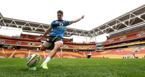 Joey Carbery practices his kicking during Ireland's captain's run ahead of the first test with Australia. Photo: Dan Sheridan/Inpho
