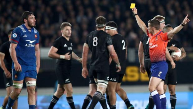 Match referee Luke Pearce hands Paul Gabrillagues of France a yellow card early in the second half of the first Test against New Zealand at Eden Park in Auckland. Photograph: Hannah Peters/Getty Images