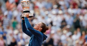 Romania's Simona Halep celebrates by lifting the trophy after winning the final of the French Open  against Sloane Stephens of the United States at Roland Garros in Paris. Photograph: Pascal Rossignol/Reuters
