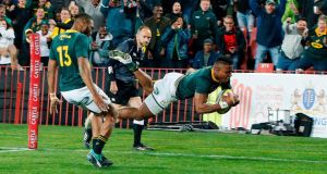 South Africa's centre Aphiwe Dyantyi scores a try. Photograph: Getty Images