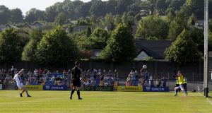 Cavan's Martin Reilly scores a penalty  in Aughrim. Photograph: Bryan Keane/Inpho