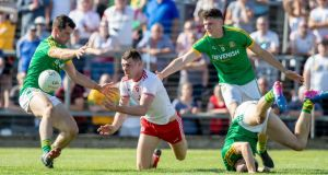 Meath's Adam Flanagan, Conor McGill and Donal Keogan close down Padraig McNulty of Tyrone in Navan. Photograph: Morgan Treacy/Inpho