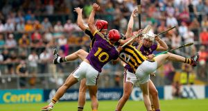 Kilkenny's Enda Morrissey and Cillian Buckley in action against  Lee Chin and Rory O'Connor of Wexford during the  Leinster SHC round-robin  match at Nowlan Park. Photograph: James Crombie/Inpho