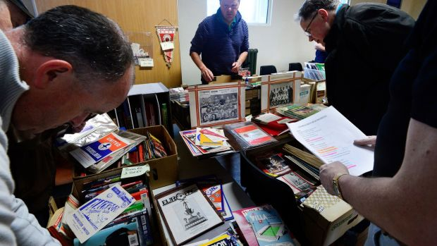 Programme collectors flick through some of the options on offer. Photograph: Cyril Byrne