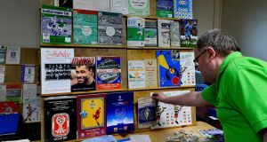 Robert Wilson looks at some of the rare matchday programmes on offer at the Irish Football Programme Club's annual fair at St Andrews Resource Centre, Pearse Street. Photograph: Cyril Byrne