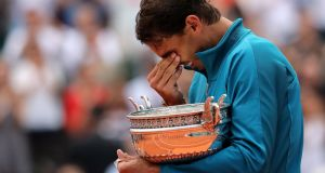 An emotional Rafael Nadal celebrates his French Open final victory over Austria's Dominic Thiem at Roland Garros. Photograph: Pascal Rossignol/Reuters