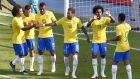 Brazil players celebrate  a goal during their 3-0 victory against Austria in an international friendly   on Sunday  in Vienna. Photograph:   Getty Images