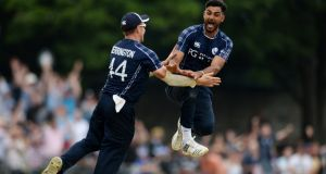 Safyaan Sharif celebrates after taking the final wicket of Mark Wood as Scotland beat England in a  One-Day International match  at Grange Cricket Club in Edinburgh. Photograph: Philip Brown/Getty Images