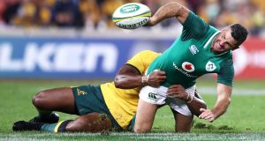 Rob Kearney passes as he is tackled during the international Test match against between the Australian Wallabies  on Saturday. Photograph: Mark Kolbe/Getty Images