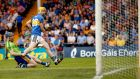 Clare goalkeeper Donal Tuohy and Tipp's Jake Morris  watch on  as the  substitute's shot hits  the post in a pivotal moment during yesterday's game. Photograph: James Crombie