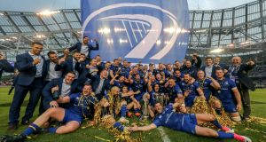 Leinster players celebrate with the Pro14 and Champions Cup trophies. Photo: Billy Stickland/Inpho