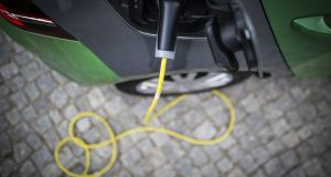 The cost of driving 20,000km in an EV is somewhere between €250 and €500 a year depending on the home electricity package used, while running a petrol car for the same distance will cost at least €2,000. Photograph: Getty Images