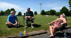 John Byrne, Eddie O'Grady and Marian Morton from Castleknock enjoying the sunshine in the Phoenix Park, Dublin. Photograph: Dara Mac Dónaill