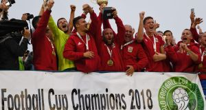 Karpatalja squad members celebrate with the trophy after winning the alternative Conifa World   Cup on Saturday in London. Photograph: Robin Millard/AFP/Getty Images