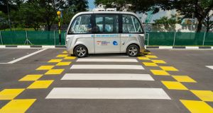 A Navya SAS autonomous electric passenger bus  at the test circuit  in Singapore. The centre has intersections, traffic lights, bus stops and pedestrian crossings. Photograph: Nicky Loh/Bloomberg