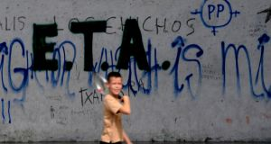 A boy walks past graffiti supporting Eta in Mondragón, Basque Country, Spain,  photographed in September  2010. File photograph: Vincent West/Reuters