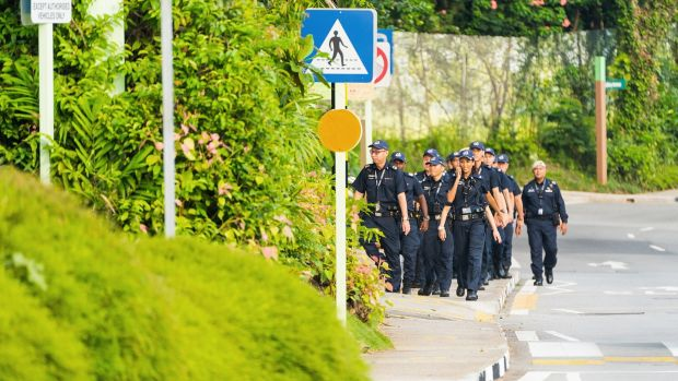 Police officers patrol the area around the Capella Hotel in Singapore on Monday. Photograph: Nicky Loh/Bloomberg