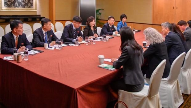In this photo released by the US State Department, members of the North Korean delegation (left), meet with members of the US delegation during a working group meeting on Monday in Singapore, a day before President Donald Trump will meet North Korean leader Kim Jong-un. Photograph: US State Department/AP