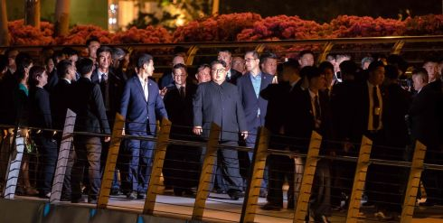 ON WALKABOUT: North Korean leader Kim Jong-un (centre) on walkabout in Singapore's Marina Bay area, overlooking the city-state's skyline. He took a night-time stroll around some of Singapore's sights ahead of his summit with US president Donald Trump on Tuesday. Photograph: Nicholas Yeo/AFP/Getty Images