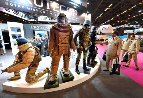 ARMY FASHIONS: Military officers look at equipment manufactured by French company Protecop which is on display at the Eurosatory Defence and Security international exhibition in Villepinte, near Paris. Photograph: Gerard Julien/AFP/Getty Images