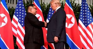 North Korea leader Kim Jong Un  shakes hands with US President Donald Trump  at the start of their historic summit in Singapore. Photograph: Saul Loeb/AFP/Getty Images