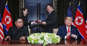 The summit between US president Donald Trump and North Korean leader Kim Jong-un. The document being exchanged between US secretary of state Mike Pompeo (2-R) and North Korean leader's sister Kim Yo Jong (2-L) moments after it was signed by Mr Trump and Mr Kim. Photograph: Kevlin Lim/EPA/The Strait Times/