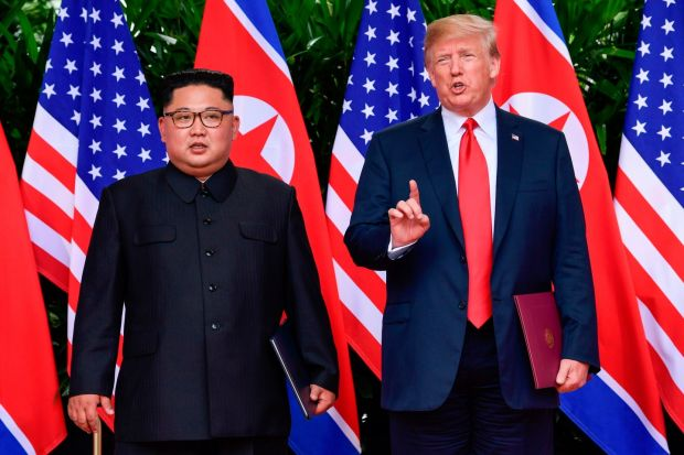 US president Donald Trump makes a statement before saying goodbye to North Korea leader Kim Jong-un (L) after their meetings at the Capella resort on Sentosa Island in Singapore on Tuesday. Photograph: Susan Walsh/AFP/Getty Images
