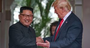 North Korea's leader Kim Jong-un  shaking hands with US president Donald Trump  in Singapore. Photograph: AFP/the Straits Times/ Kevin Lim