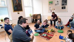 Parent Matt Healy reading a story at the London Irish Playgroup  in the London Irish Centre in Camden. Photograph: Malcolm McNally