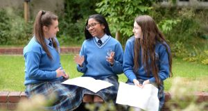Students at Mount Carmel Secondary School, King's Inns Street, Dublin, discuss their exams. Photograph: Dara Mac Dónaill