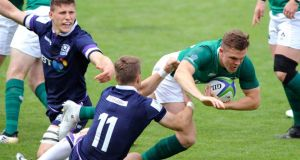Michael Silvester is tackled during Ireland's defeat to Scotland in Perpignan. Photograph: Pascal Rodriguez/Inpho