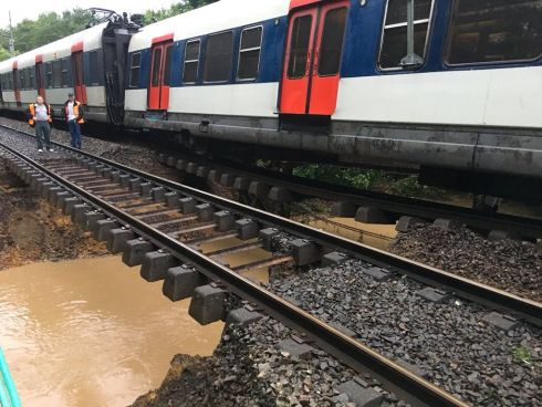 OFF THE RAILS: A derailed train between Saint-Remy-les-Chevreuse and Courcelles Sur Yvette, in France, in the wake of rainwater floods in recent days. Photograph: Twitter/@Said_Haddou/Reuters