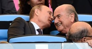 Russian president Vladimir Putin  speaks to former Fifa president Sepp Blatter during the 2014 World Cup. Photograph: Dylan Martinez/Reuters