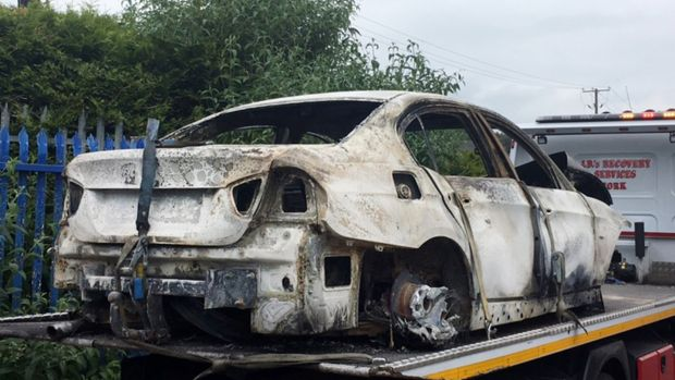 A burned out car which is suspected to have been used as a getaway vehicle in the murder of Mikolaj Wilk. Photograph: Daragh Mc Sweeney/Provision