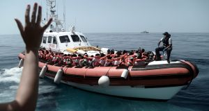 Some of the 629 migrants boarding rescue vessel Aqarius in the Mediterranean. Photograph: Kenny Karpov/Handout/EPA